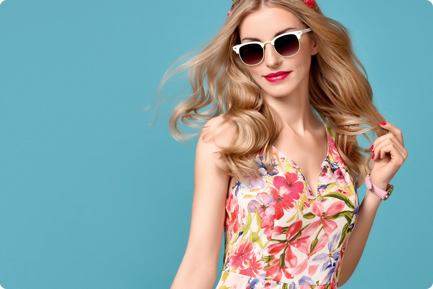 Woman modeling sunglasses and watch on a teal background