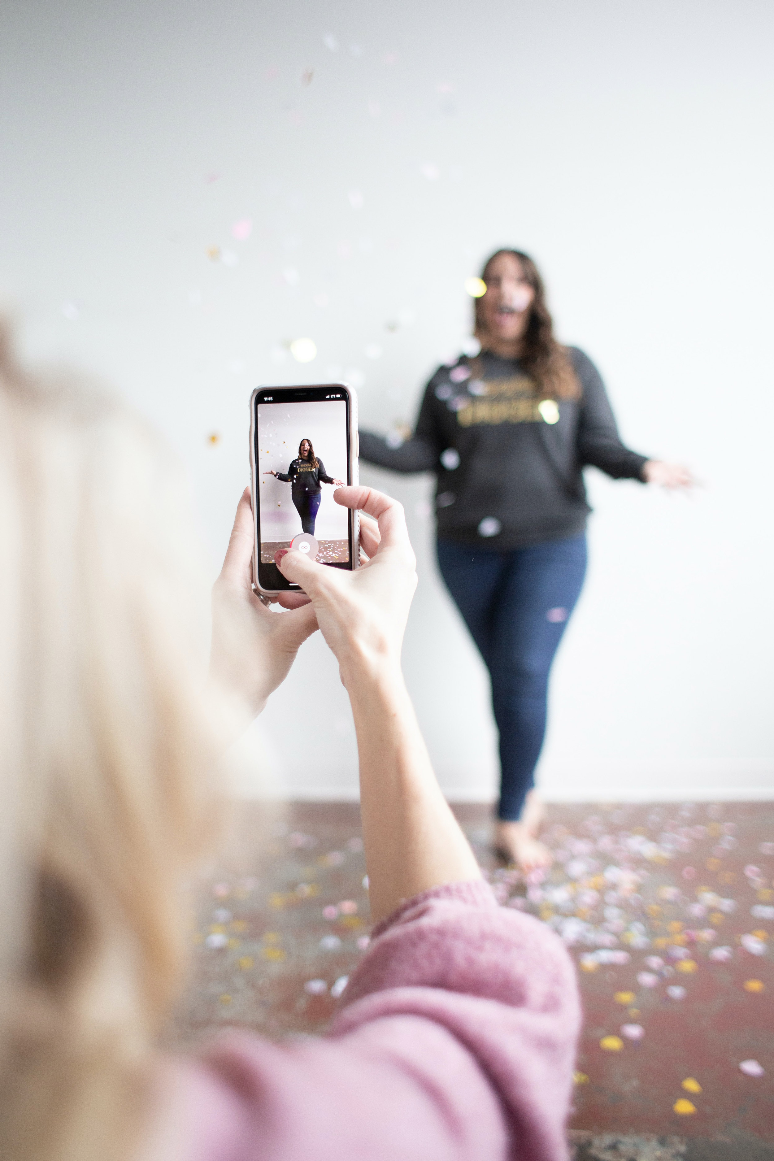 girl filming another girl on a smart phone