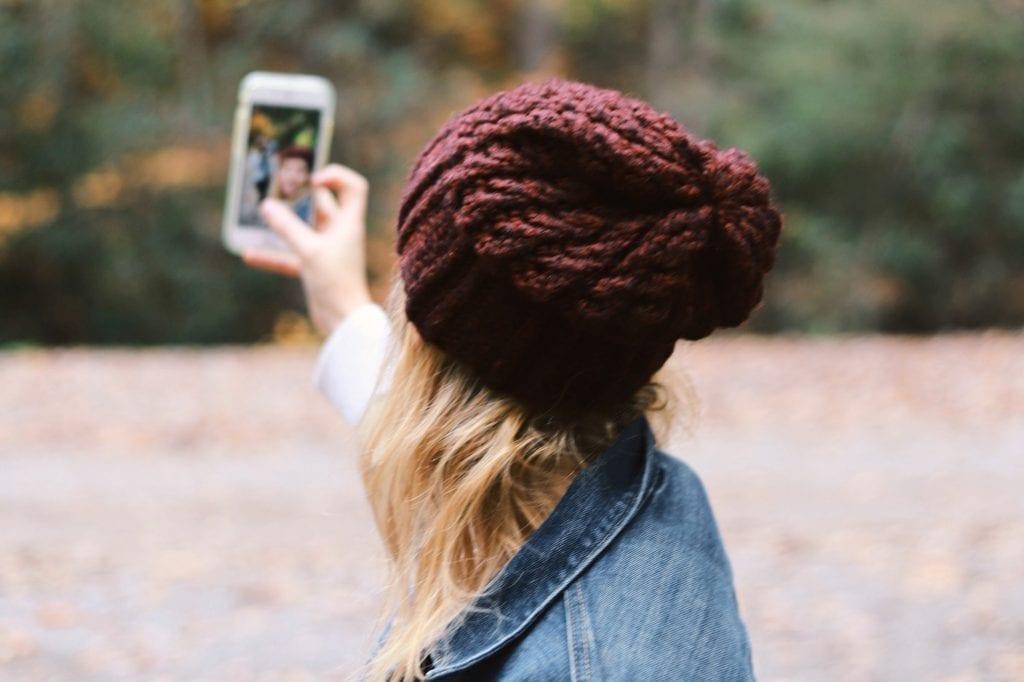 Woman Records Instagram Reel on Phone