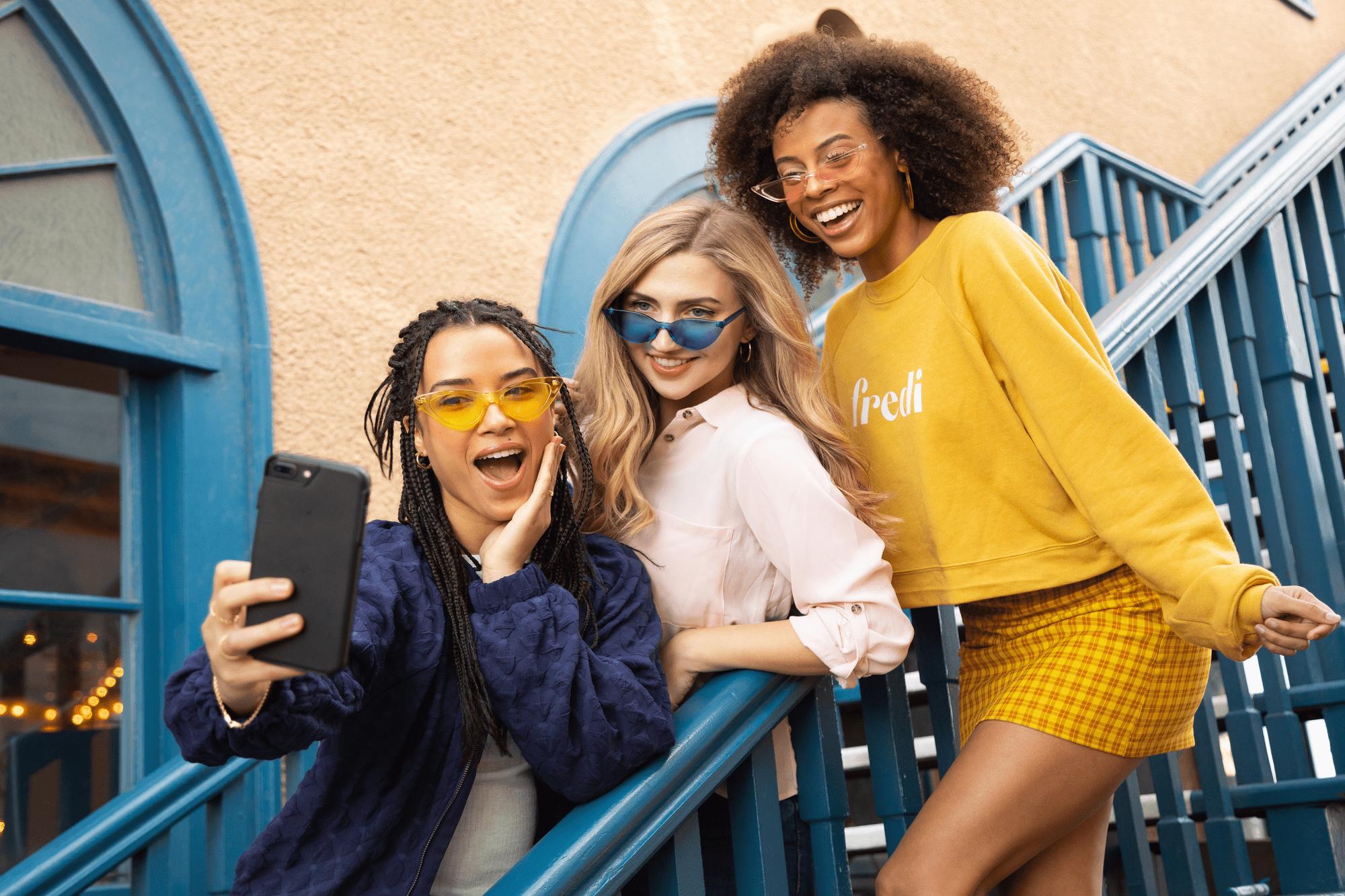 3 happy teen girls taking selfie for tiktok advertising