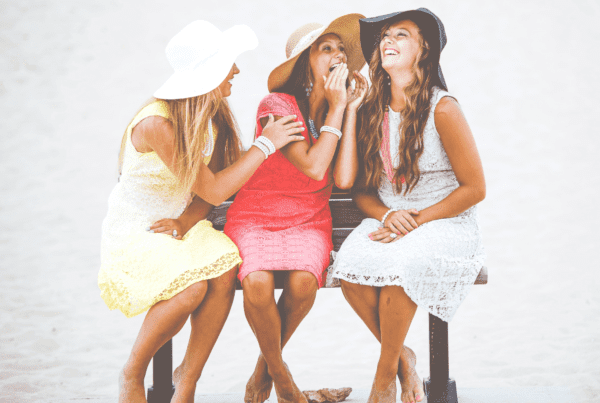 three women telling secrets about premium content
