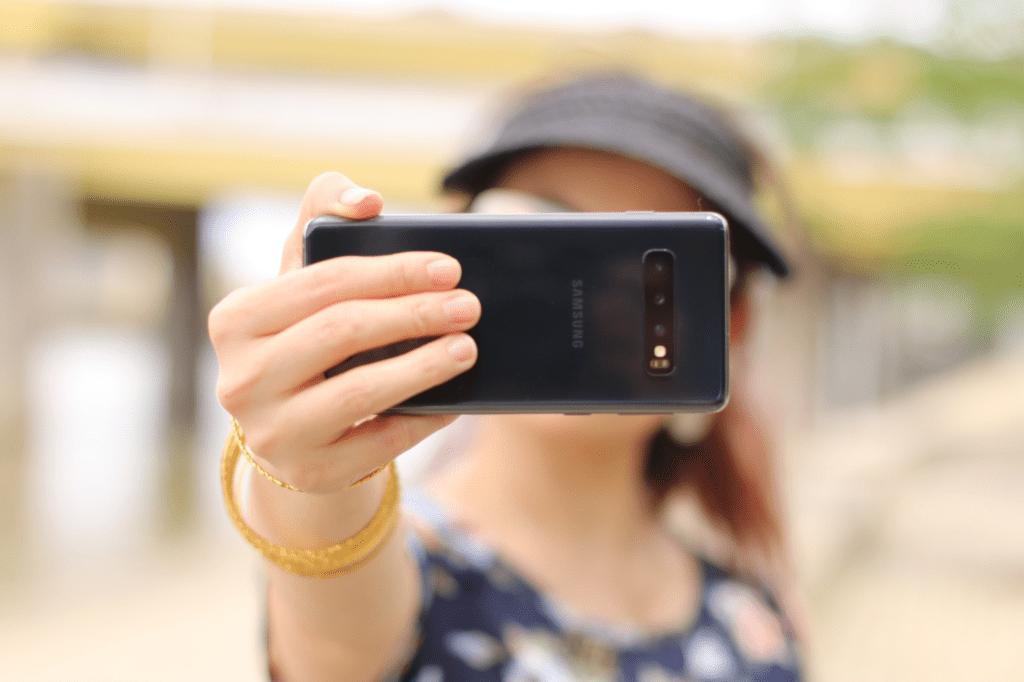 woman taking selfie for instagram reels remix