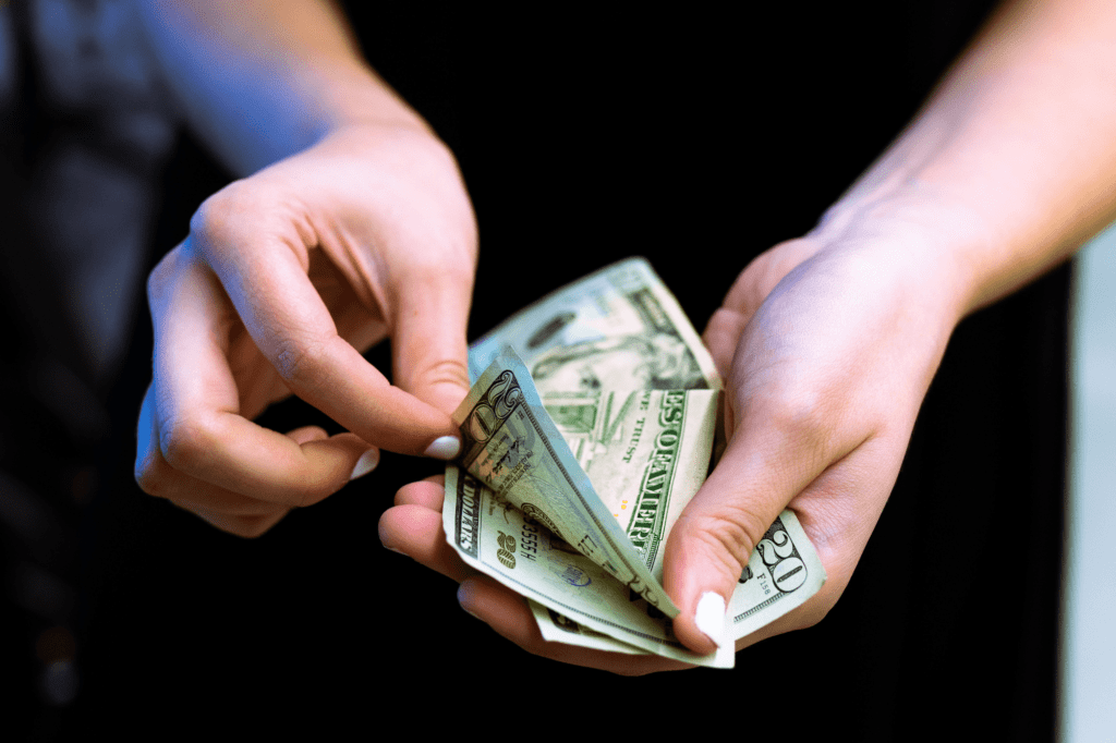 woman's hands with cash for clubhouse payments