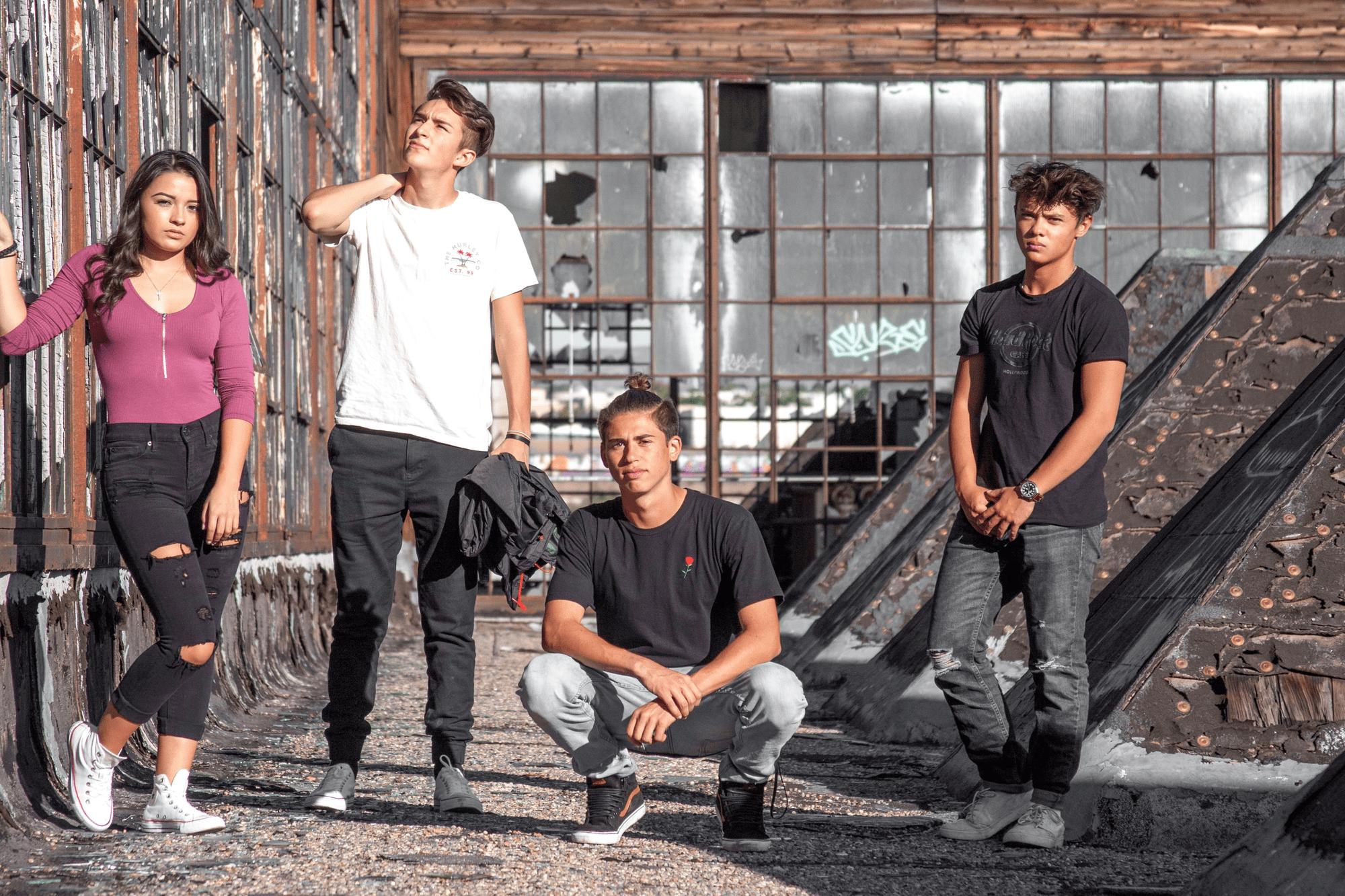 four teens posing as top gen z influencers