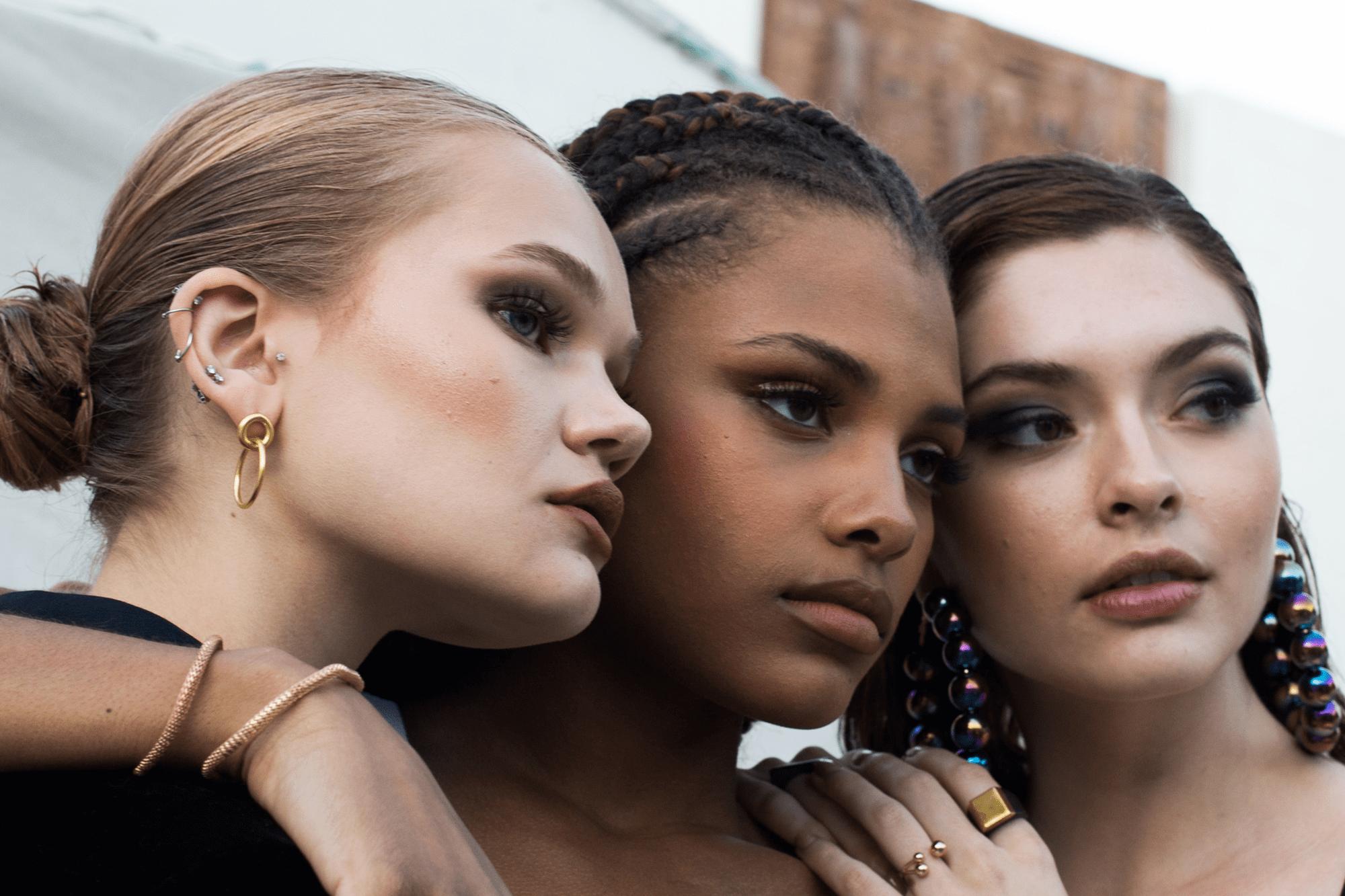 three beautiful women posing for facebook marketing trends