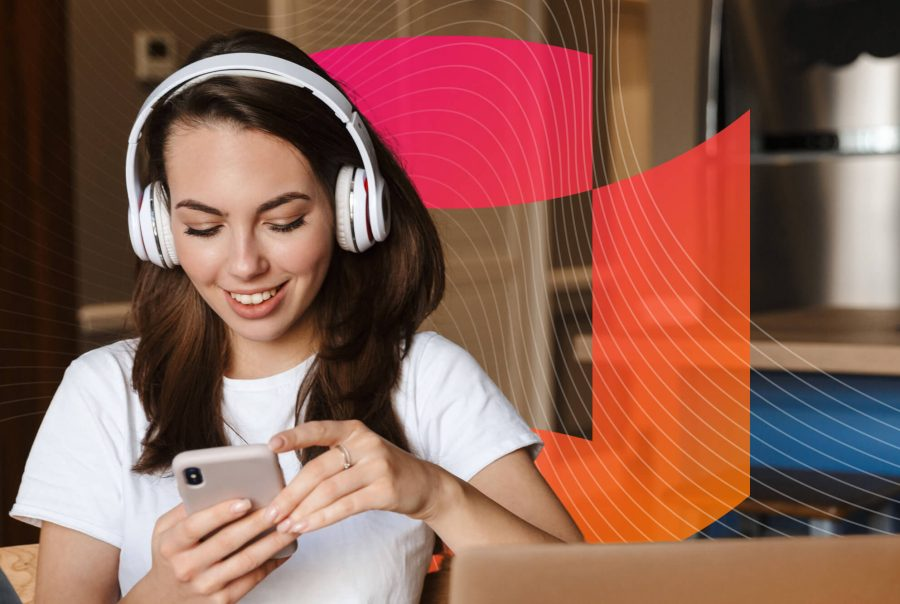 Person with headphones listening to audio on a mobile app