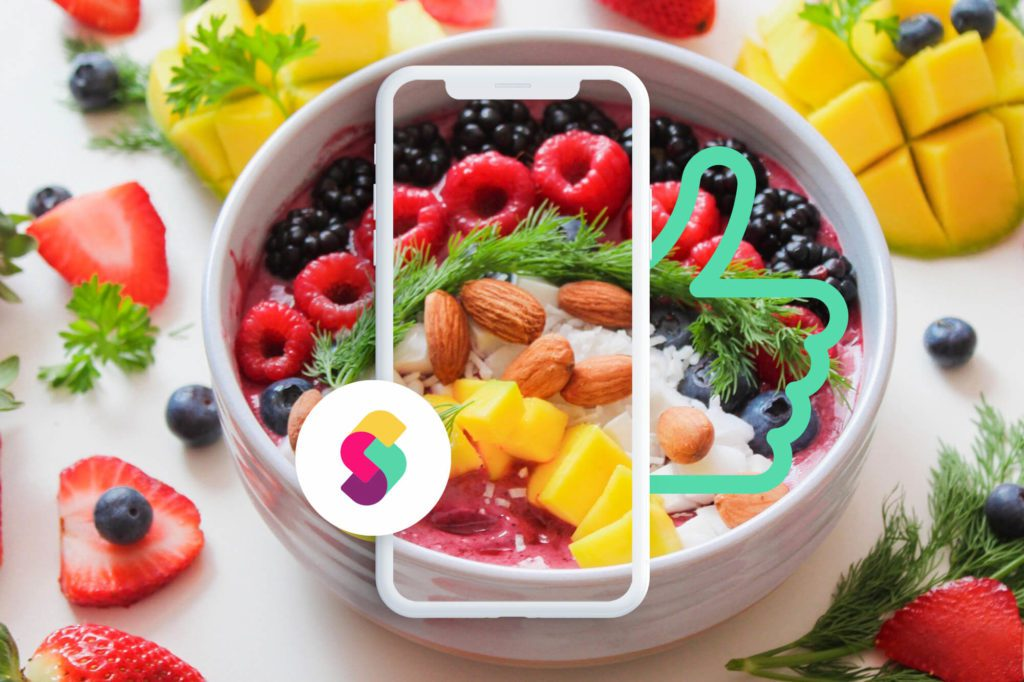 Bowl of food with image of a phone and a thumb in front