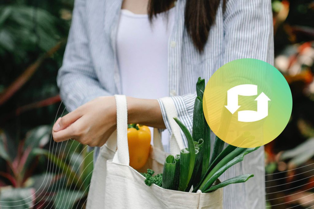Person carrying produce in a reusable bag