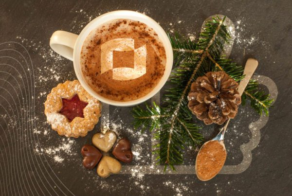 cup of coffee, a holiday cookie and a pine cone